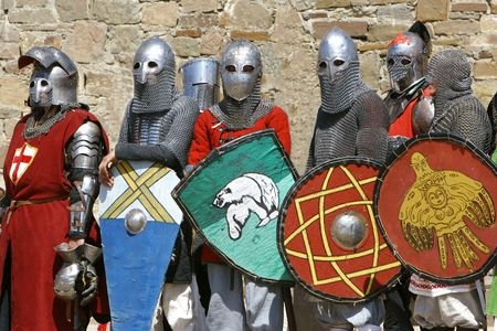 jousting: several knights on stone wall background