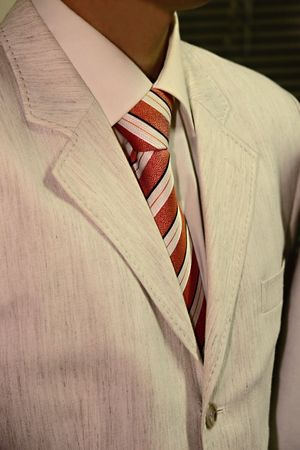dinner jacket: male tuxedo in beige formal suite