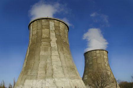 gaseous: smoking chimneys on blue sky background