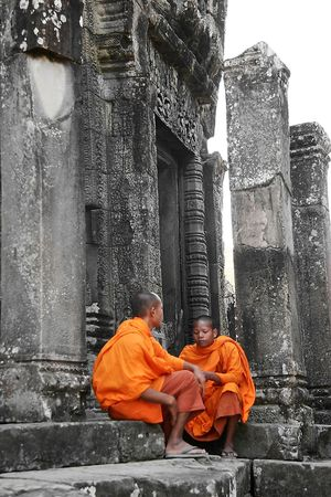 novice: two young monks on temple background