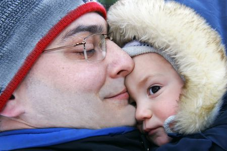 foster parenting: father and son outdoor portrait