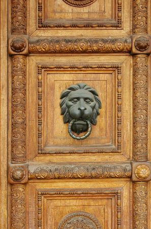 bronzy: wooden door with lion-head door-knob Stock Photo
