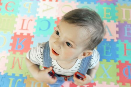 boy on colorful background with letters Stock Photo - 2852813