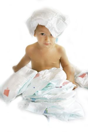 boy playing with diapers over white