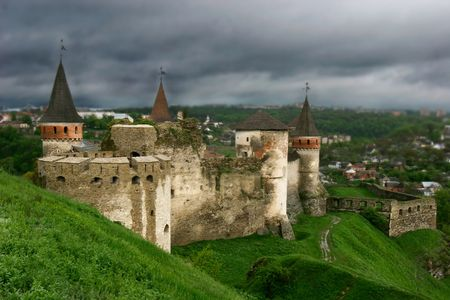 old castle on cloudy sky background photo