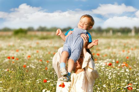 mother and son on natural background photo