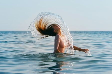 caucasian water drops: girl with long hair in the sea