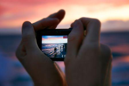 teniendo la foto a la puesta del sol, se centran en la pantalla