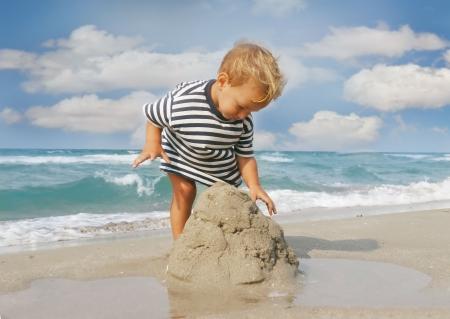 children sandcastle:  boy playing on beach