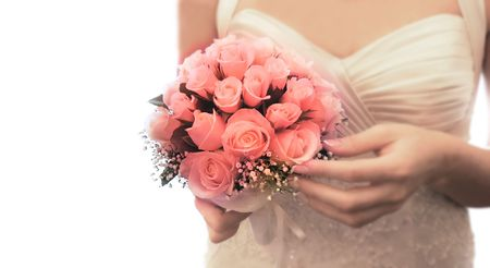finders: wedding bouquet in brides hands over white Stock Photo