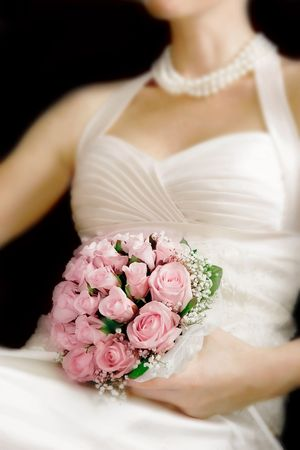 finders: wedding bouquet in brides hands, focus on flowers