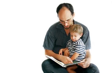 father reading a book to his son photo
