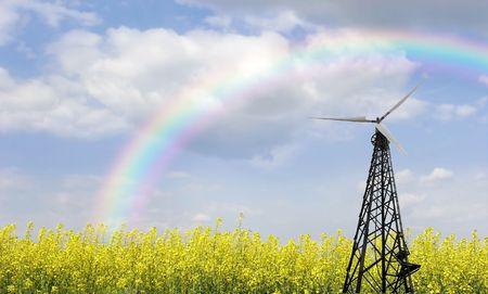 windturbine aan weide en regenboog achtergrond