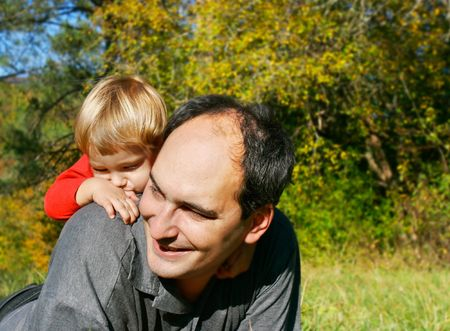 fatherhood: father and son outdoor portrait