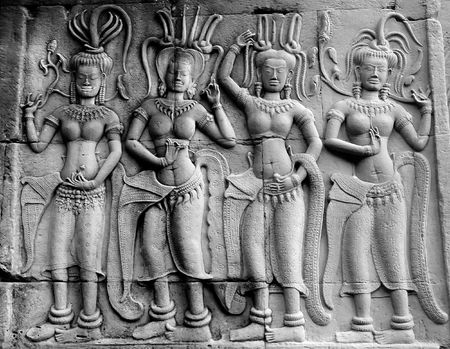 stone dancers carved on wall photo