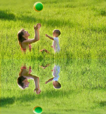 mother and son playing with colorful ball