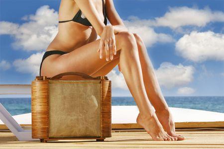 swimming trunks: girl ready for travelling on sea resort