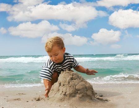 playing boy on beach Stock Photo