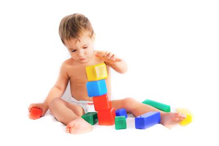 child playing with bulding blocks over white