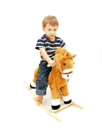 boy on rocking horse over white photo