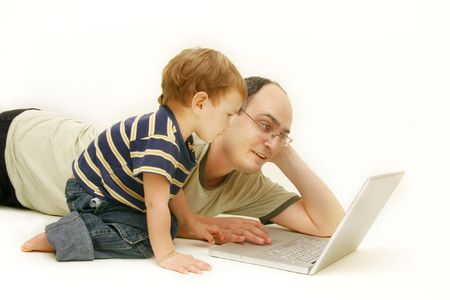 father and son with laptop over white photo