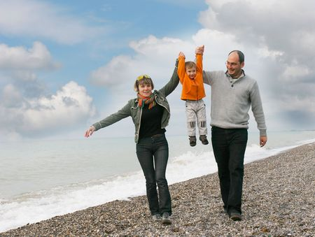 foster parenting: happy family on beach Stock Photo