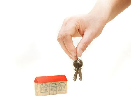 hand with keys from new house over white Stock Photo - 4362395