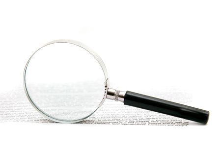 magnifier over text on white background Stock Photo - 4362426