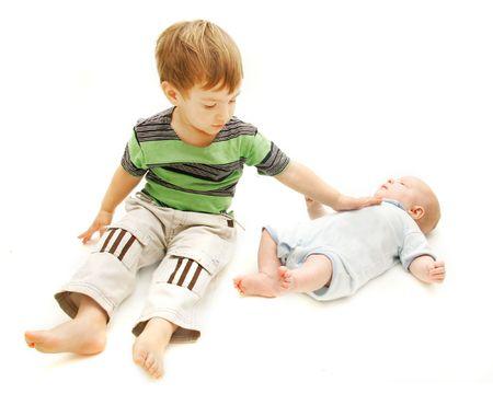 nursing sister: toddler and baby over white