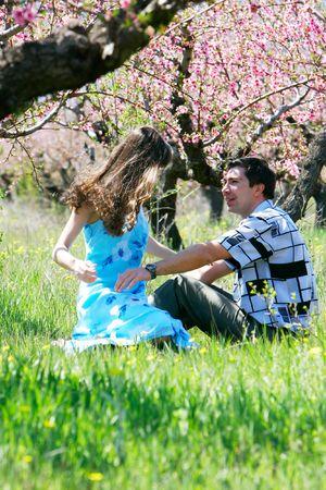 brune: loving couple in spring garden