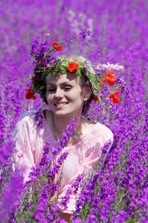 portrait of happy girl in violet flowers photo