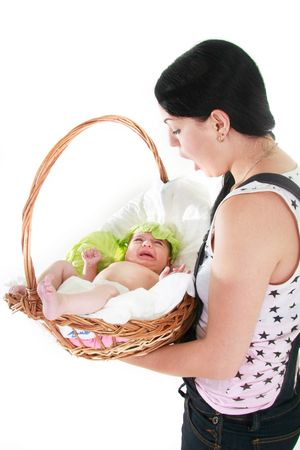 surprised woman with baby found in basket over white photo