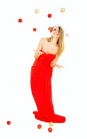 attractive santa girl throwing xmas balls over white Stock Photo - 5137094