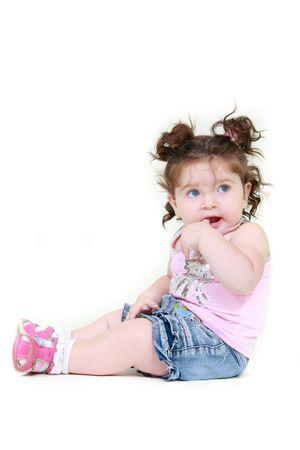 brune: cute toddler girl over white
