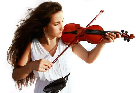 attractive girl playing violin over white photo