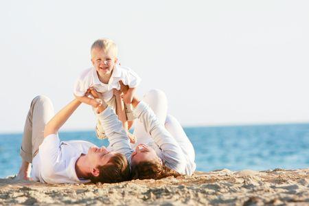 happy family having fun on beach Stock Photo
