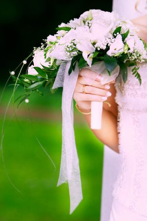 close  up of bridal hand with wedding bouquet Stock Photo - 5696297