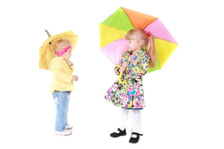 two girls with colorful umbrellas over white photo