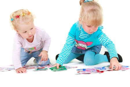 two girls playing with colorful letters over white photo