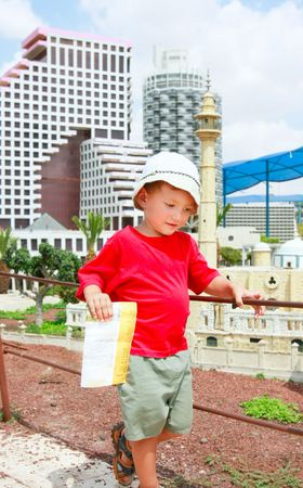 young tourist with map on travel destination background photo