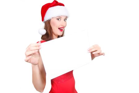 happy santa girl with blank banner in hands photo