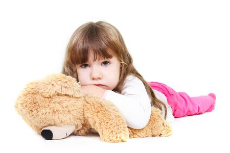 sad girl with teddy bear over white photo