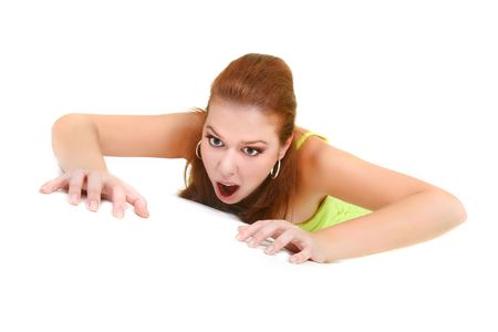 to creep: attractive woman crawling over white