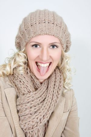 studio shot of happy woman in winter clothes photo