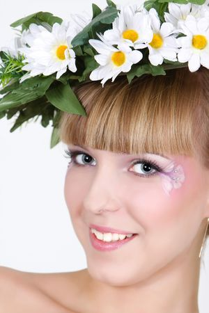 beautiful girl in floral wreath photo