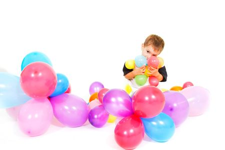 express positivity: cute boy playing with colorful balloons over white