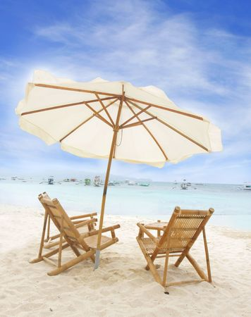 chairs and umbrella on sand beach Stock Photo