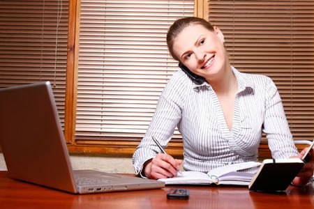 attractive business woman at work Stock Photo - 7768731