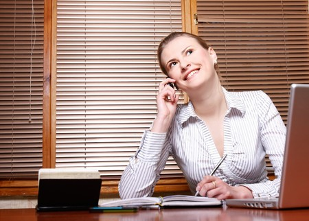 attractive business woman at working place Stock Photo - 7769314