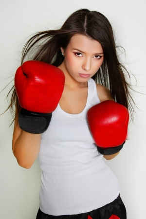 woman boxing gloves: studio shot of beautiful female boxer
